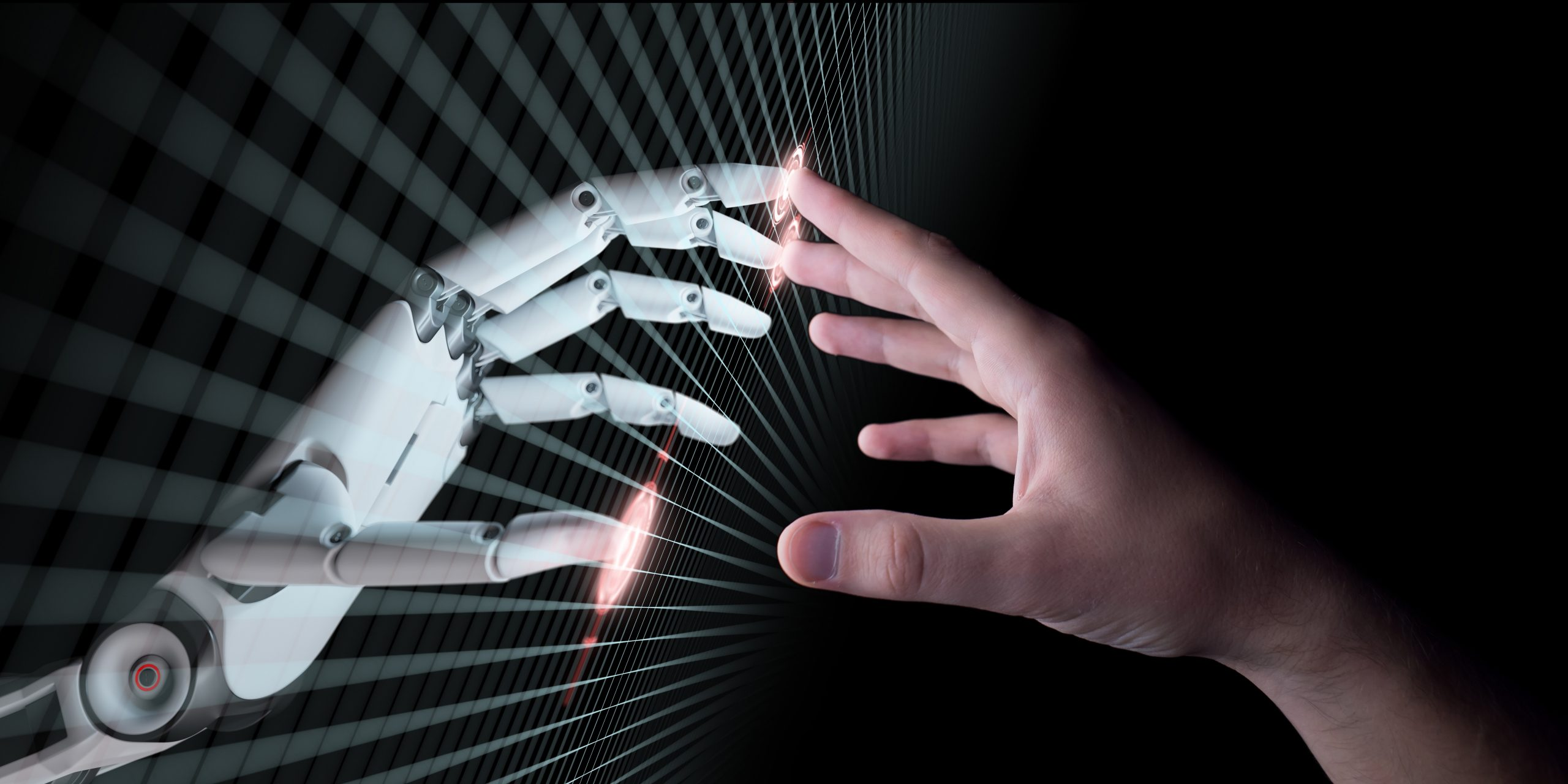 human and robot hands touch